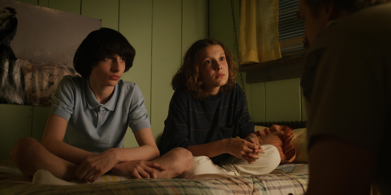 David Harbour, Millie Bobby Brown, and Finn Wolfhard in Stranger Things (2016)