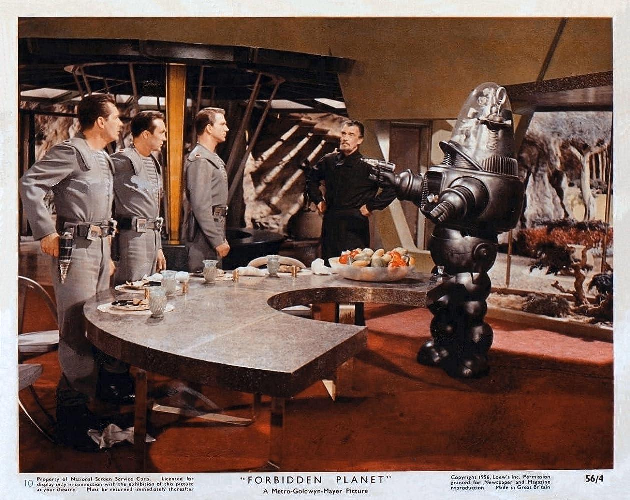 Leslie Nielsen Jack Kelly Walter Pidgeon Warren Stevens and Robby the Robot in Forbidden Planet 1956