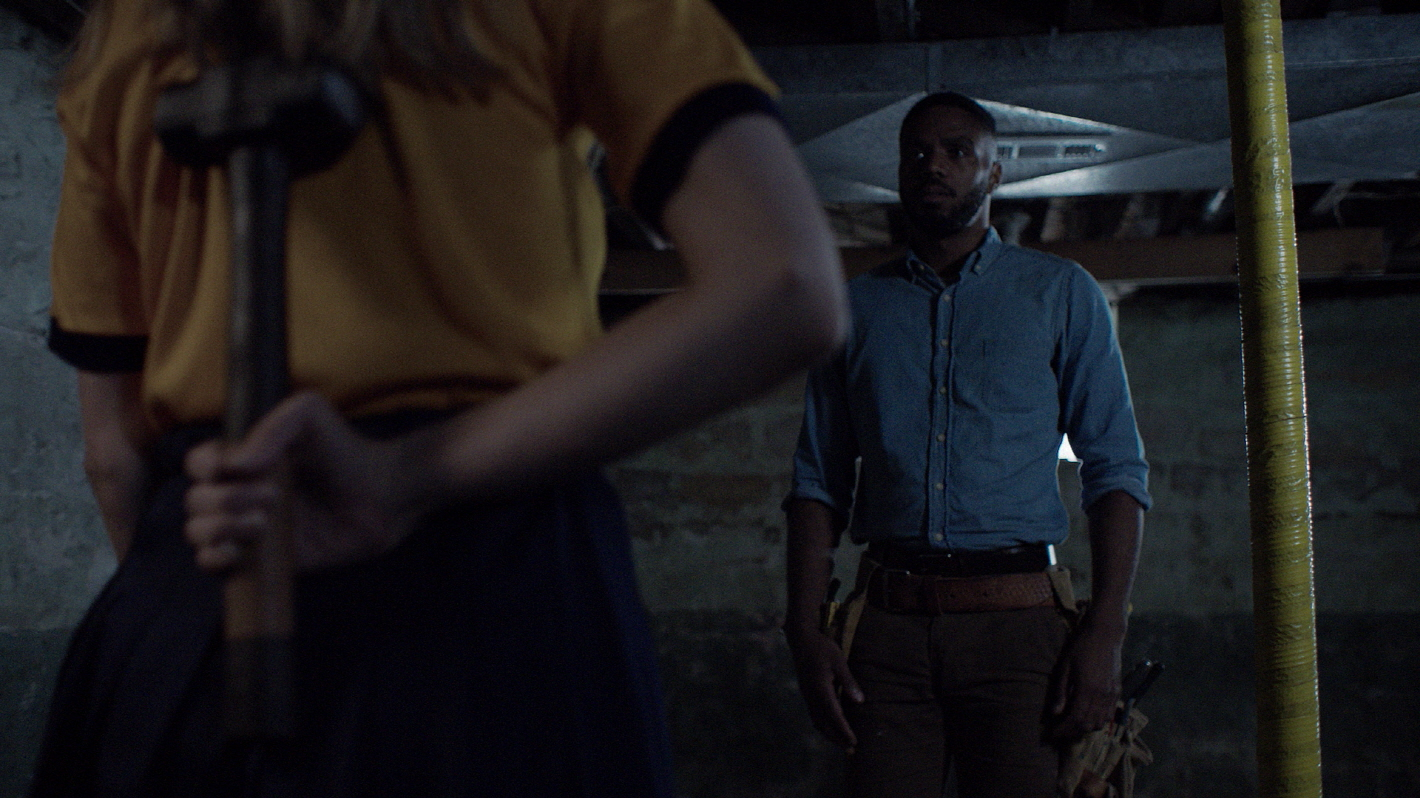 Travis Delgado and Sarah Brooks in Girl on the Third Floor (2019)
