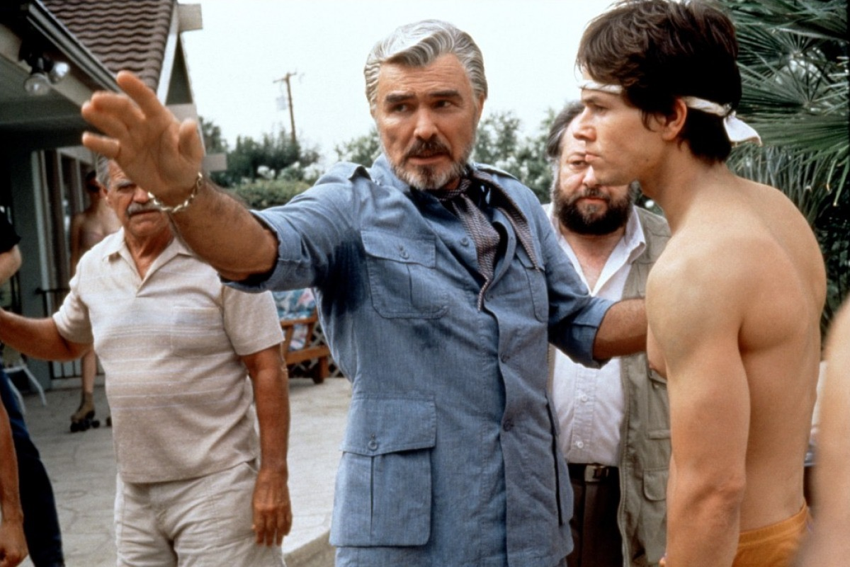 Mark Wahlberg, Burt Reynolds, Ricky Jay, and Jack Wallace in Boogie Nights (1997)