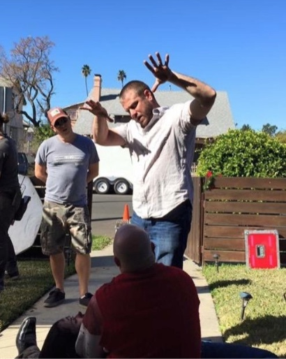 Director Ryan Nelson explains a shot to cinematographer Neil Moore on the set of Mercy Christmas.