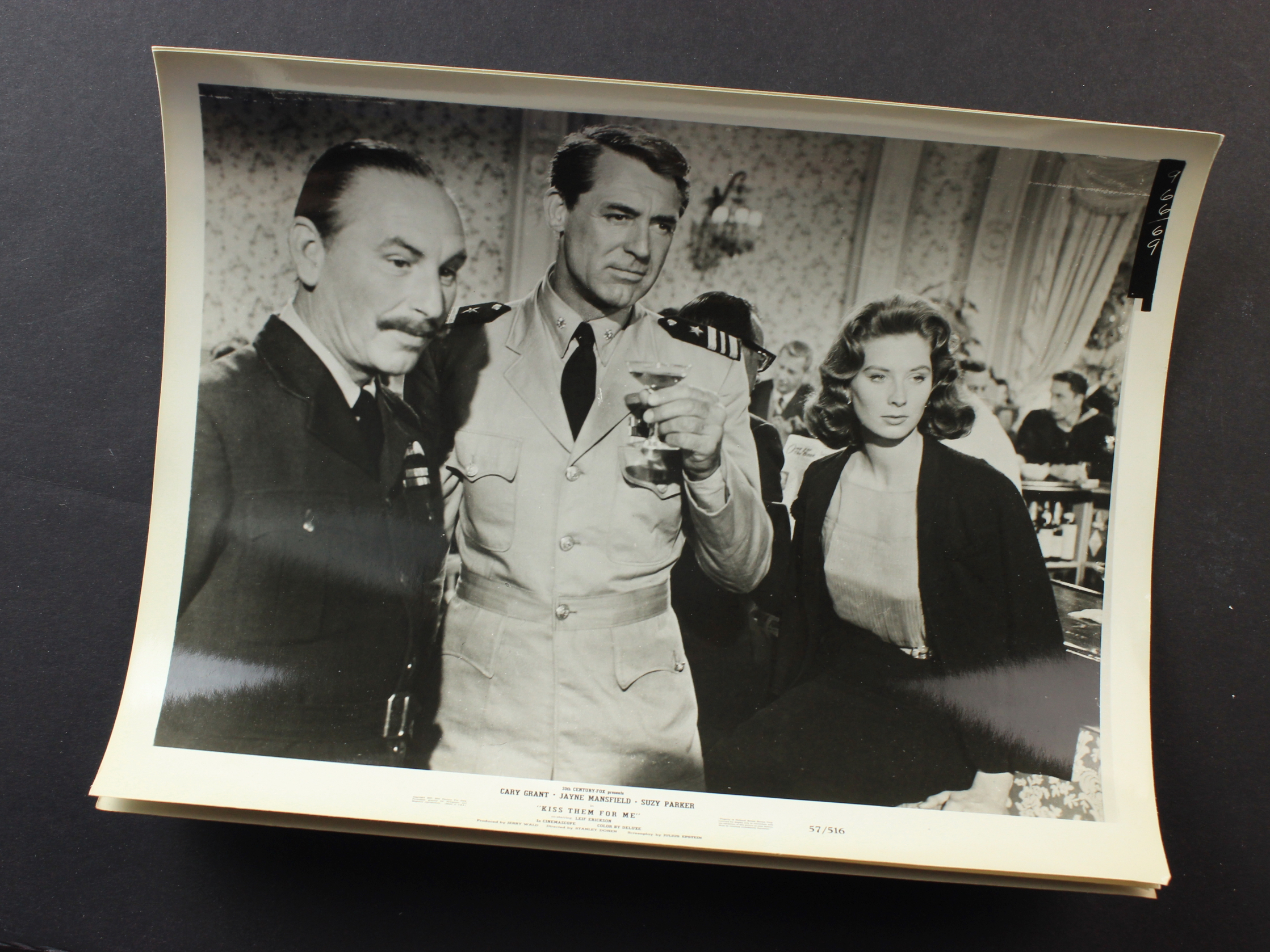 Cary Grant, George Nardelli, and Suzy Parker in Kiss Them for Me (1957)