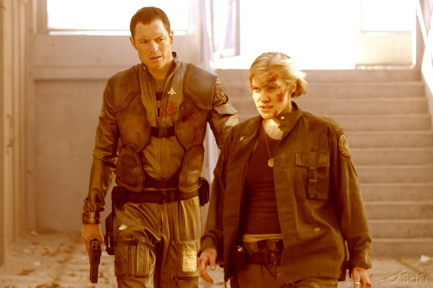 Tahmoh Penikett and Katee Sackhoff in Battlestar Galactica (2004)