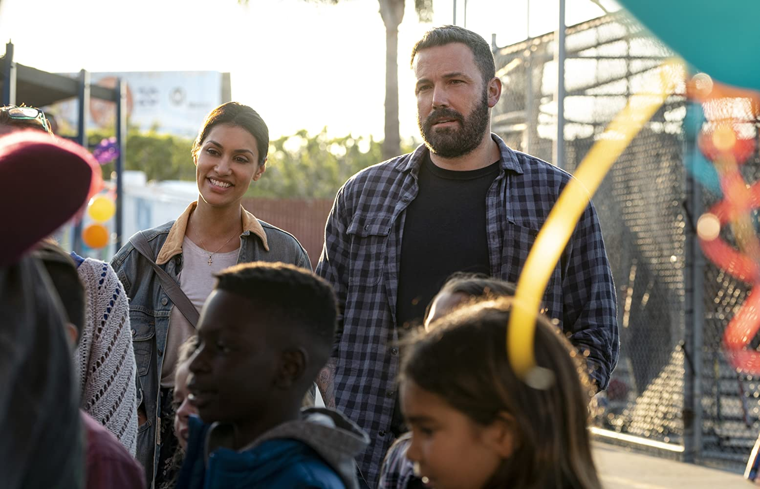 Ben Affleck and Janina Gavankar in The Way Back (2020)