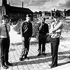 Ian Curtis, Peter Hook, Stephen Morris, Bernard Sumner, and Joy Division in Joy Division (2007)