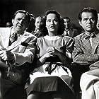 Elisha Cook Jr., Thomas Mitchell, and Merle Oberon in Dark Waters (1944)