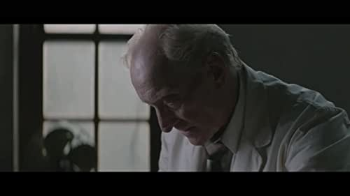 After killing his mother and her lover some years before, Patrick is the comatose patient in room 15 of a remote, private psychiatric clinic.