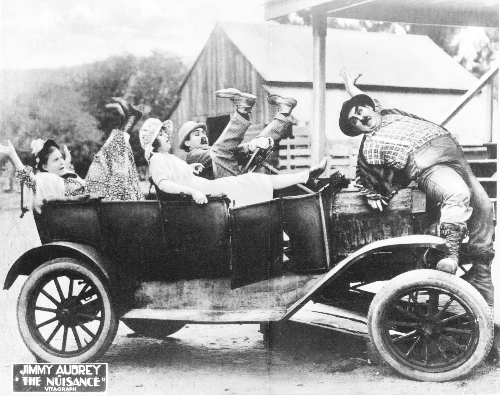 Oliver Hardy, Jimmy Aubrey, Rosa Gore, and Leila McCarthy in The Nuisance (1921)