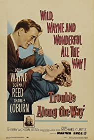 John Wayne and Donna Reed in Trouble Along the Way (1953)