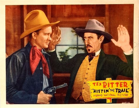 Earl Dwire and Tex Ritter in Hittin' the Trail (1937)