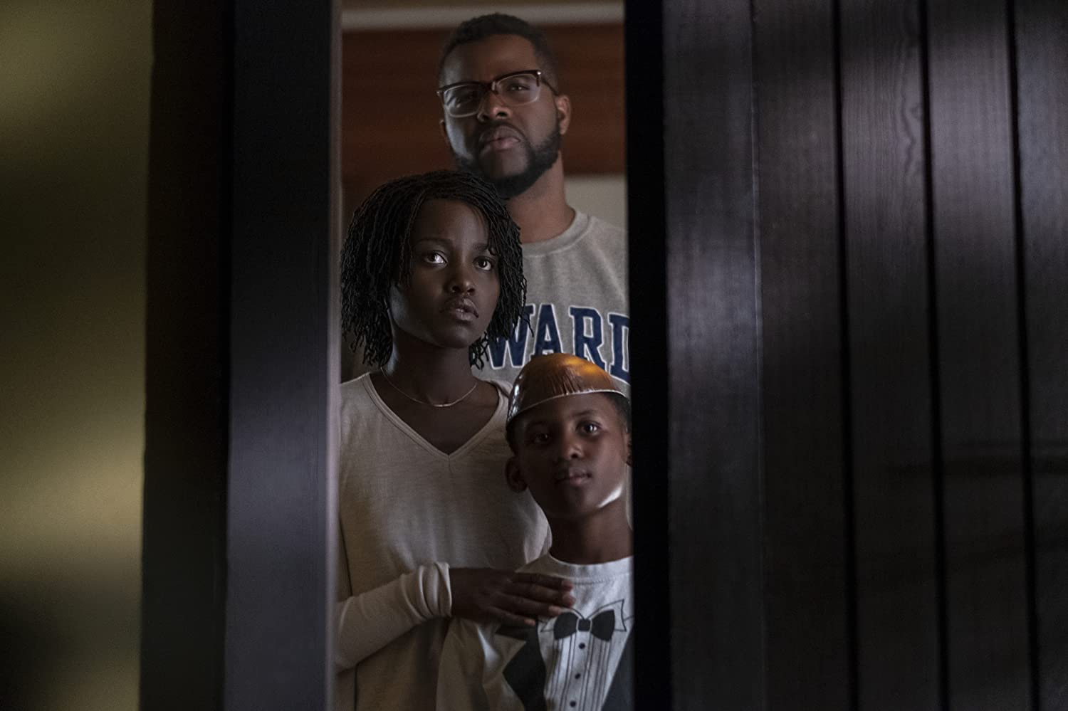 Lupita Nyong'o, Winston Duke, and Evan Alex in Us (2019)