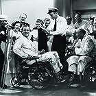 John Wayne, Tige Andrews, Dan Dailey, Louis Jean Heydt, Mae Marsh, and Henry O'Neill in The Wings of Eagles (1957)