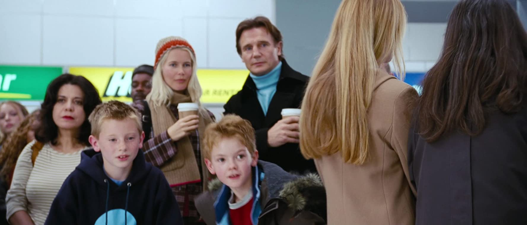 Liam Neeson, Claudia Schiffer, Patrick Delaney, and Thomas Brodie-Sangster in Love Actually (2003)