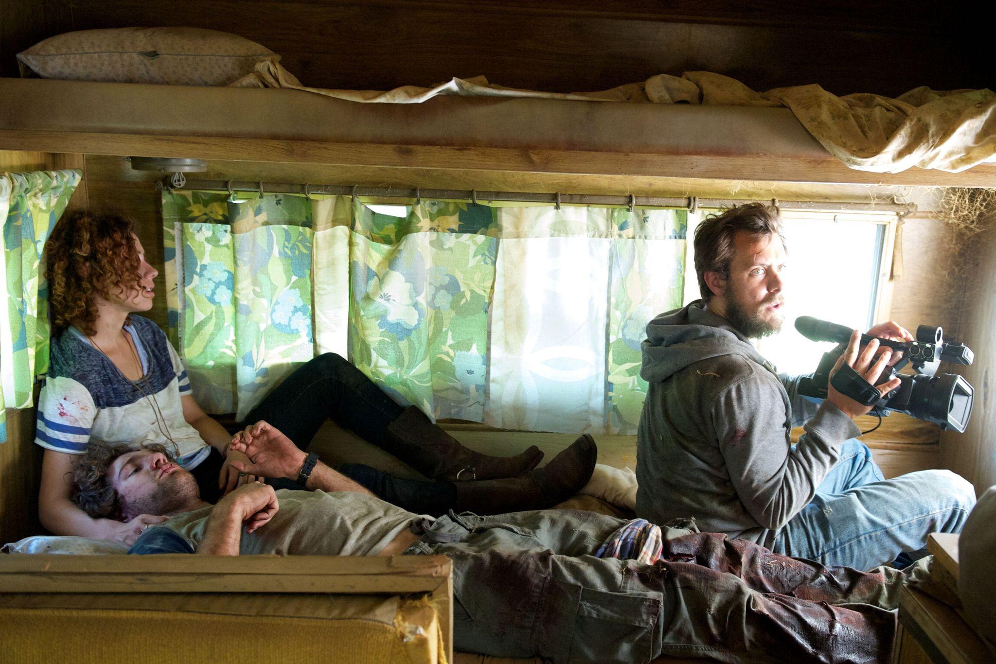 Dora Madison, Chris Osborn, and Samuel Davis in Exists (2014)