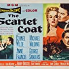 George Sanders, Anne Francis, Cornel Wilde, and Michael Wilding in The Scarlet Coat (1955)