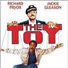 Jackie Gleason, Richard Pryor, and Scott Schwartz in The Toy (1982)