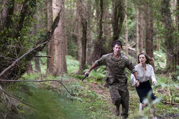 Joe Flanigan and Catherine Walker in Ferocious Planet (2011)