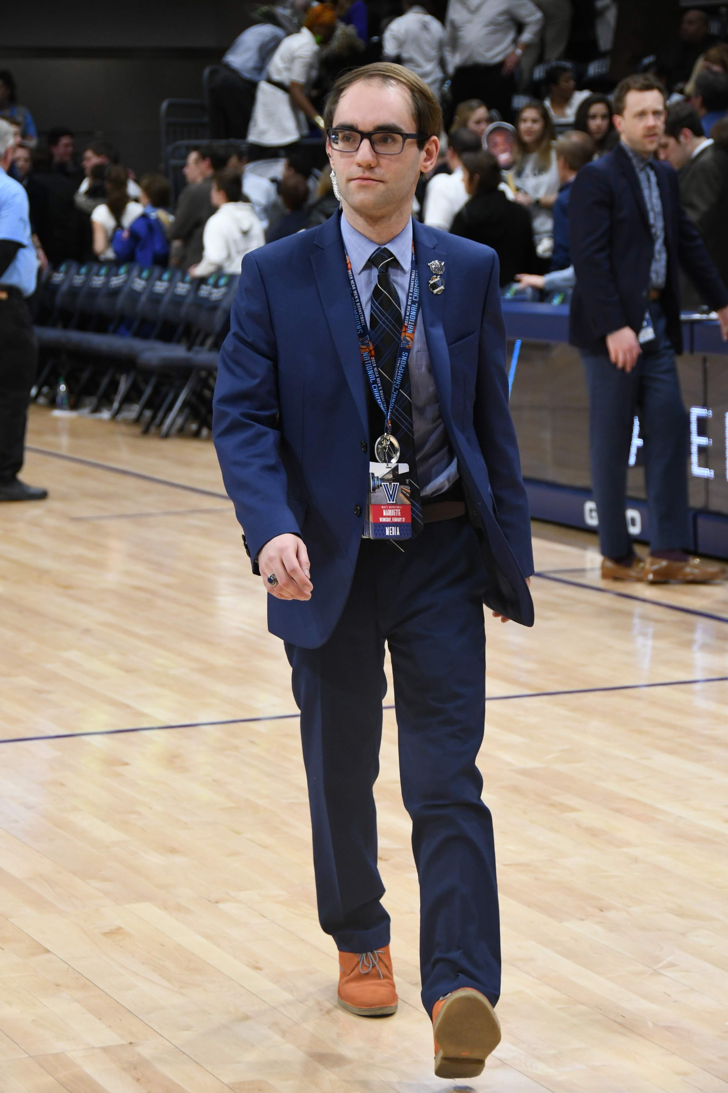 Andrew McKeough walks across the basketball court in the Finneran Pavilion at Villanova University after a Men's Basketball game in March of 2019