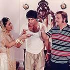 Juhi Chawla, Kader Khan, and Akshay Kumar in Mr. & Mrs. Khiladi (1997)