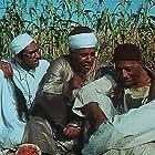 Hamdy Ahmed, Yehia Chahine, and Mahmoud Al Meleji in Al-ard (1969)