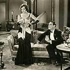 Neil Hamilton and Marian Nixon in Ex-Flame (1930)