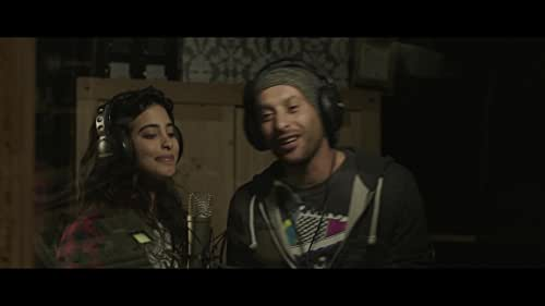 """When his family is struck by unimaginable tragedy, Kareem, a young Palestinian musician who lives in a destitute town a few kilometers east of Tel Aviv, finds refuge in the world of hip hop. As Kareem's star potential as """"the first Arab rapper"""" garners attention, his own political consciousness grows and his lyrics become more defiant toward the oppressive political climate. Joined by his girlfriend Manar who sings alongside Kareem, the two decide to use their songs to fight against oppression through the universal language of music."""