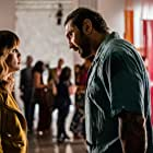 Dave Bautista and Natalie Morales in Stuber (2019)