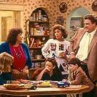 John Goodman, Roseanne Barr, Sara Gilbert, Michael Fishman, Alicia Goranson, and Laurie Metcalf in Roseanne (1988)