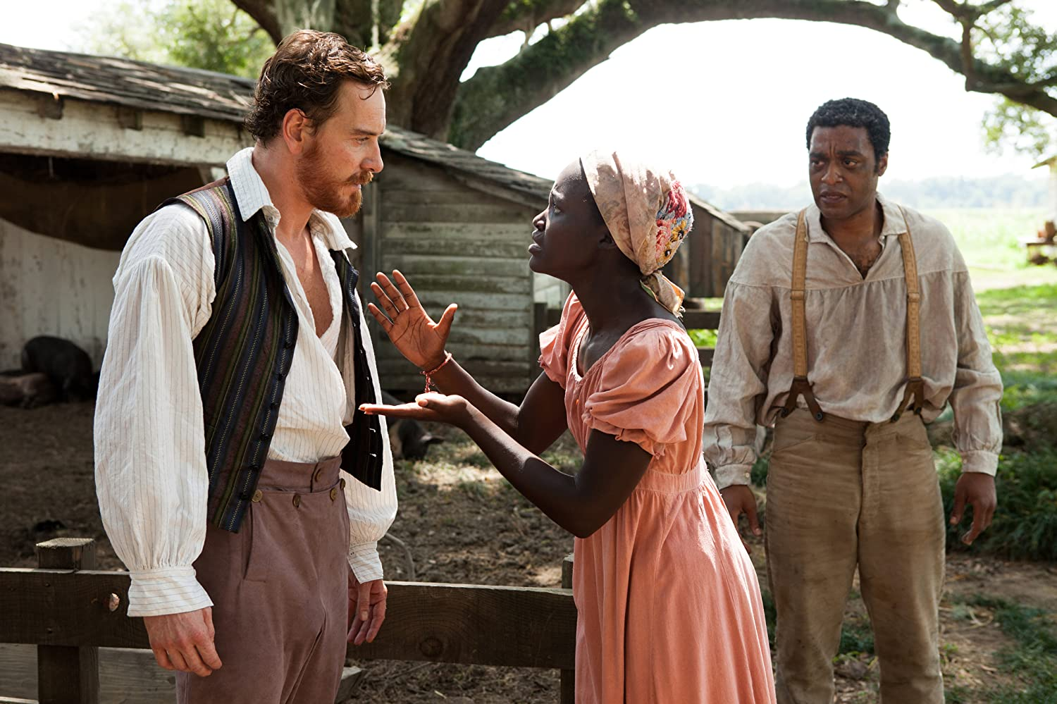 Chiwetel Ejiofor, Michael Fassbender, and Lupita Nyong'o in 12 Years a Slave (2013)