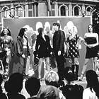 Geri Horner, Emma Bunton, Melanie C, Victoria Beckham, Mel B, and Jonathan Ross in Spice World (1997)