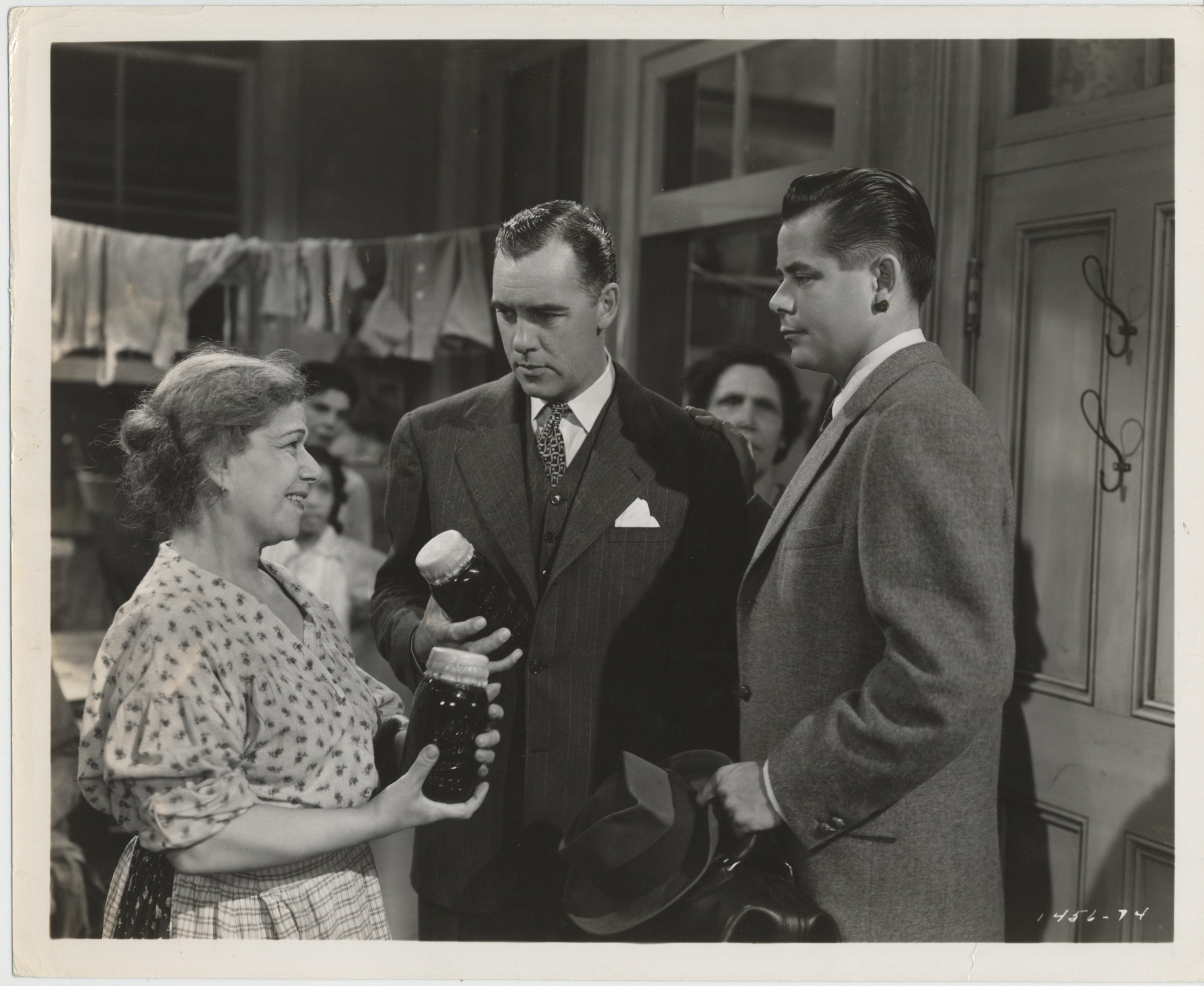 Glenn Ford, Mimi Aguglia, and Warner Anderson in The Doctor and the Girl (1949)
