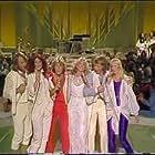 Olivia Newton-John, Benny Andersson, Agnetha Fältskog, Andy Gibb, Anni-Frid Lyngstad, Björn Ulvaeus, and ABBA in Olivia (1978)