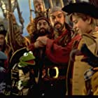 Tim Curry, Kevin Bishop, and Kermit the Frog in Muppet Treasure Island (1996)