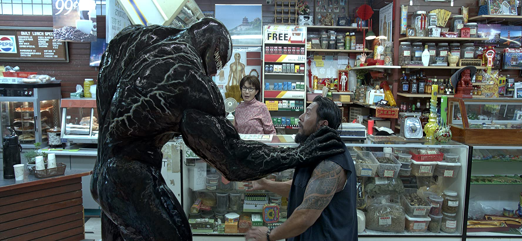 Peggy Lu and Sam Medina in Venom (2018)