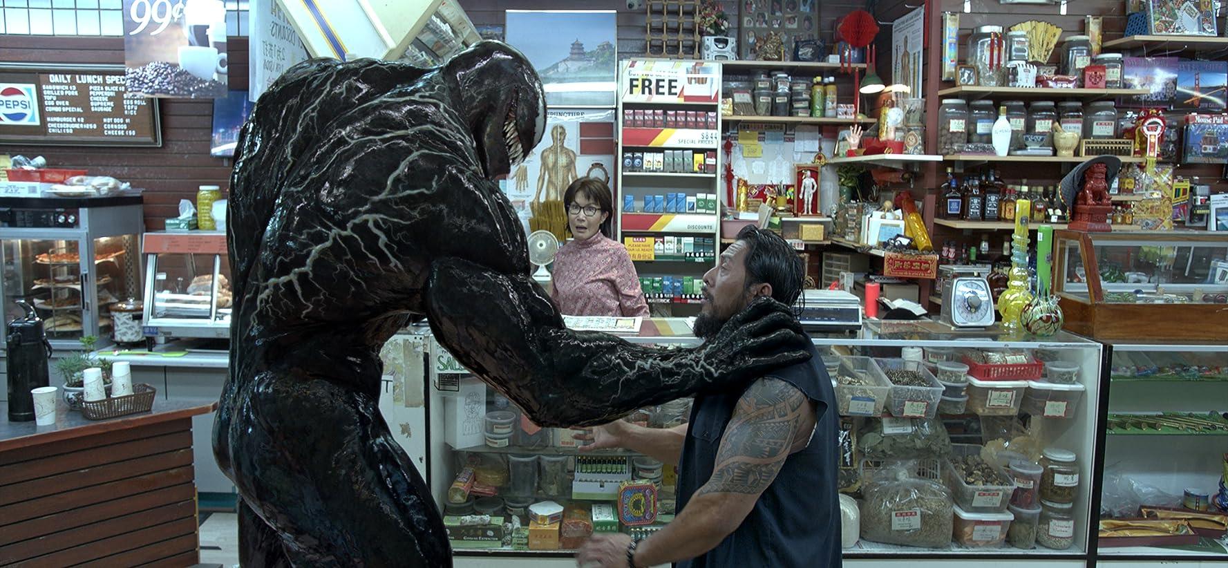 Peggy Lu and Sam Medina in Venom (2018)