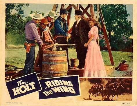 Joan Barclay, Tim Holt, Charles R. Phipps, Lee 'Lasses' White, and Ray Whitley in Riding the Wind (1942)