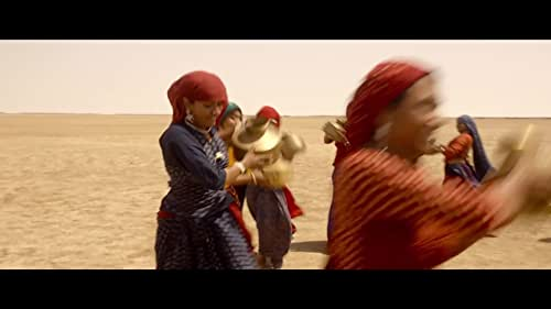 A group of suppressed women from a village in Gujarat find someone in the desert and their lives are changed forever.