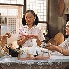 Baoguo Chen and Gaowa Siqin in Xiang hun nü (1993)