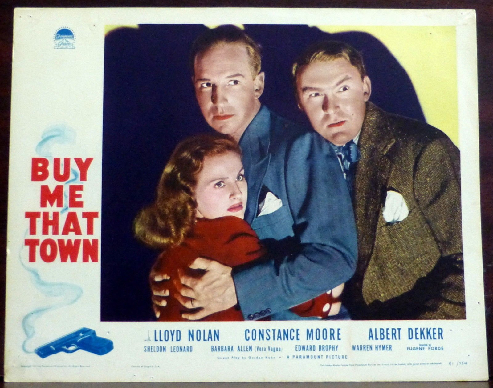 Albert Dekker, Constance Moore, and Lloyd Nolan in Buy Me That Town (1941)