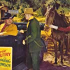 Gene Autry, Lon Chaney Jr., Tracy Layne, and Champion in The Singing Cowboy (1936)