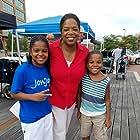 "Oprah Winfrey, Jaylon Gordon, and Johnnie Gordon on the set of ""The Immortal Life of Henrietta Lacks"" in Baltimore"