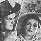 Dick Foran and Alma Lloyd in Song of the Saddle (1936)