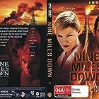 Adrian Paul and Kate Nauta in Nine Miles Down (2009)