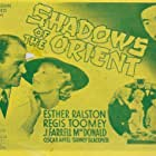 Patrick Cunning, Chester Gan, Esther Ralston, and Regis Toomey in Shadows of the Orient (1935)