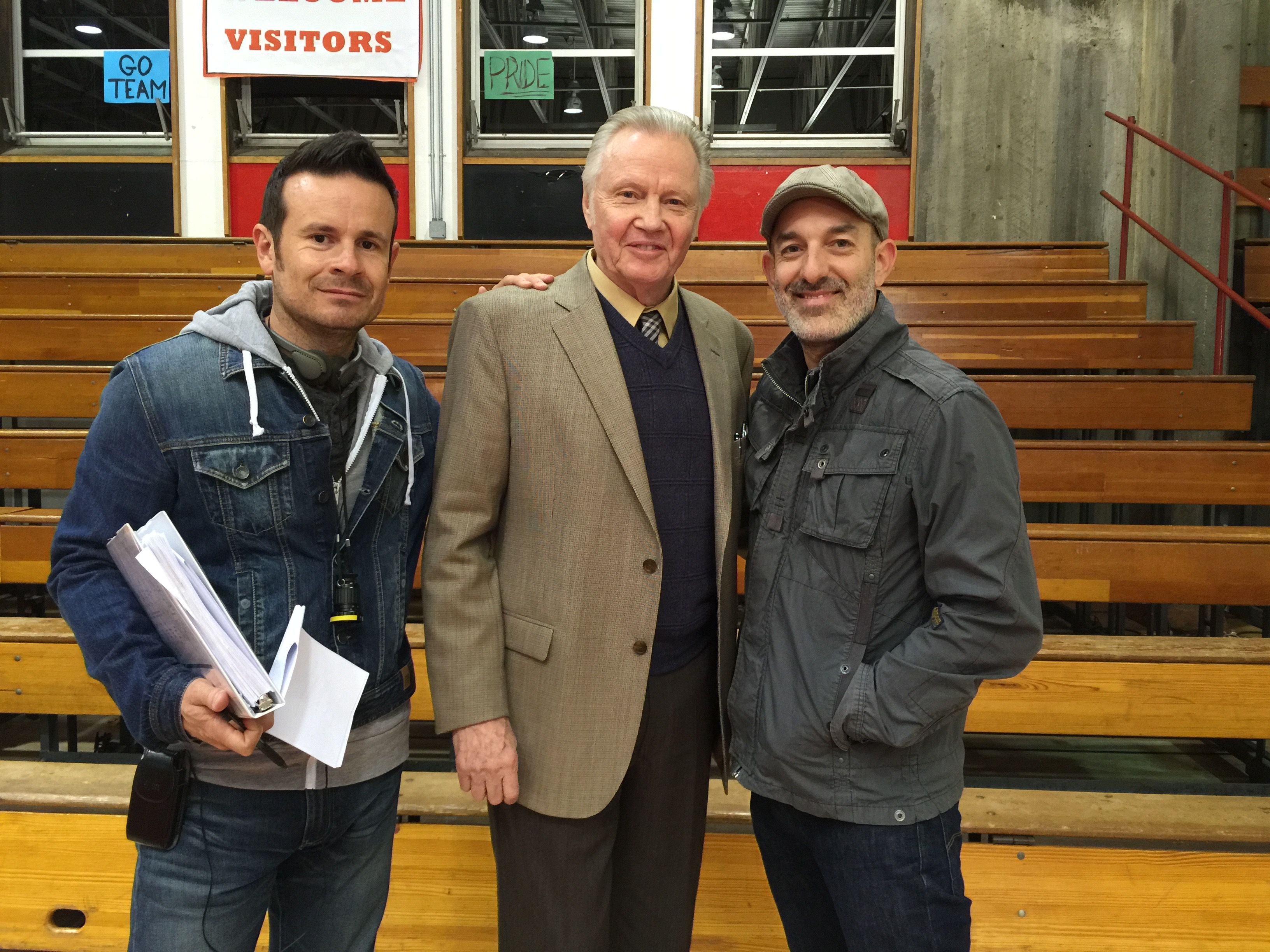 Director Alex Ranarivelo, Jon Voight, and Director of Photography Reuben Steinberg on the set of American Wrestler: The Wizard.