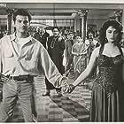 Madhuri Dixit, Sanjay Kapoor, and Mukesh Khanna in Raja (1995)