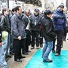 Jon Avnet demonstrating a punch to stunt coordinator Buddy Joe Hooker as Jason Issacs looks on.  Pleady Guilty (2010)