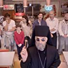Father Jimmy blesses the refurbished Three Brothers Fish & Chip Shop
