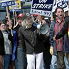 """At a labor rally she's supposed to be covering for the evening news, an inebriated Lanie (ANGELINA JOLIE) leads picketing union members in an impromptu rendition of The Rolling Stones' (""""I Can't Get No) Satisfaction."""""""