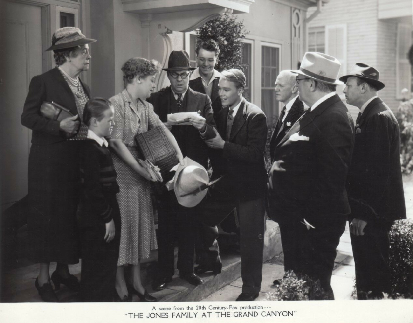 Spring Byington, Kenneth Howell, John T. Murray, Jed Prouty, and Florence Roberts in Quick Millions (1939)